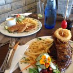 Main course ribs and chicken schnitzel