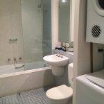 Bathroom with laundry equipment