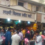 Sweets & flowers on way to Mahalakshmi Temple