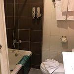 Clean bathroom with bath tub