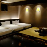 spacious triple room with tatami sitting area and dining area