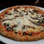 Greek pizza with added anchovy