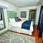 Liberty Suite bedroom featuring Queen size bed and shared hall bath