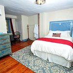 Freedom Room featuring Queen size bed with shared hall bath