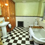 Shared Hall Bathroom (Liberty Suite & Freedom Room) with shower and clawfoot tub