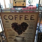 Coffee sign on door leading to breakfast room