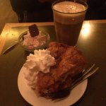 Hot apple pie with whipped cream and creamy hot chocolate