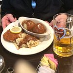 a Kleines Wiener Schnitzel with a side of Potato Dumplings and Spätzle with Rahm gravy