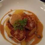 Seared Maine scallops with butternut squash purée, orange reduction and pumkin seeds