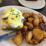 The D.S.D Benedict, served on a bacon grilled cheese sandwich! Complete with delicious homefries