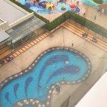 Foreground hotel pool, background Dinosaur water park