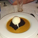 Delicious sticky toffee pudding with caramel sauce and vanilla ice cream