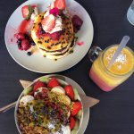 Pancakes with passionfruit coulis, açai bowl and summer sunset smoothie