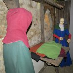Mannequins of early cloth traders
