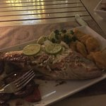 Whole grilled snapper with fried plantains and grilled vegetables