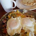 Veggie skillet with basted eggs. Meat lovers skillet scrambled