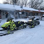 Sleds Warming Up for an Old Forge Ride in Front of Christy's