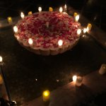 Fountain with candles and rose petals