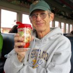 My husband with his souvenir mug of hot chocolate.