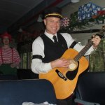 The Magical Christmas Train musician who led us in carols. Note the elf in the background.