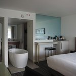 Oceanview room - The mirror is a window into the shower and that's a tub in the middle of the ro