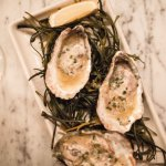 Smoked oysters with lemon garlic butter