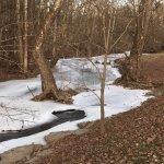 Beautiful frozen creek through the Shaker Village