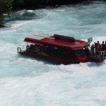 Looking down from the top of Huka Falls to the boat