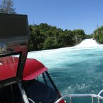 Standing on the front of the boat coming up to the Huka Falls