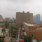 Panoramic view from room balcony, main building in front plus second room tower