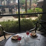 Patio view from our room. Kids' lunch once I got them from the pool!