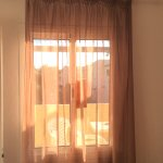Sheer curtains, neighbours can see into bedroom, bathroom and living space