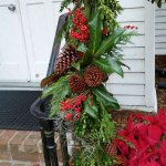 Greenery, pine cones and berries adorn the church handrail