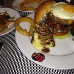 insane burger onion rings bacon pot/mushroon gravy, to, lett. onion, ementhauler and gruyer chee