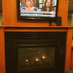 Warm fire in the breakfast room makes it easier to wake up with CNN's talking heads.