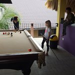 Our daughter having fun playing pool with the owners kids on the third floor restaurant level