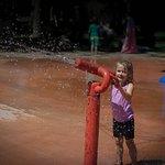 Having fun on the splash pad