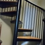 Spiral stairs to loft also contain area to store/hang jacket and boots