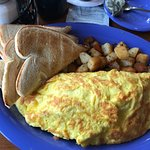 So called 2 egg omelet. At least 5 or 6.
