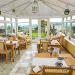 Spaciouse Conservitory for Breakfast Dining. Panoramic views