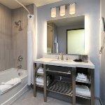 Deluxe Queen bathroom with tub