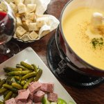 FONDUE Gruyère and emmental cheese with garlic, white wine, and kirschwasser served with crispy