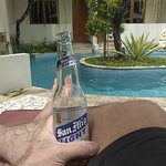 Sitting by the pool having a beer.