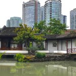 The city of Vancouver towers above the Chinese garden