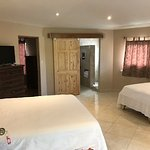 One of 2 family suites next to the main pool.  2 queen beds, 2 twin beds.