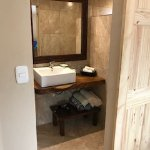 Bathroom in poolside room that has 1 king and 1 queen bed, plus views.