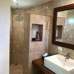 Poolside room bathroom.  Modern tile and Costa Rican wood.