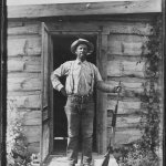 Alonzo Stepp in front of their home.