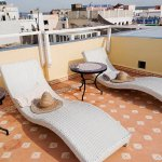 Sun lounging terrace (NB: These loungers now have comfy mattresses - photo taken last year)