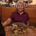 Sue with a whole snapper . . . it was delicious